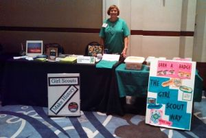 Linda Bishop, member of the GSGATL Archives Committee, at our booth at the Volunteer Leadership Conference
