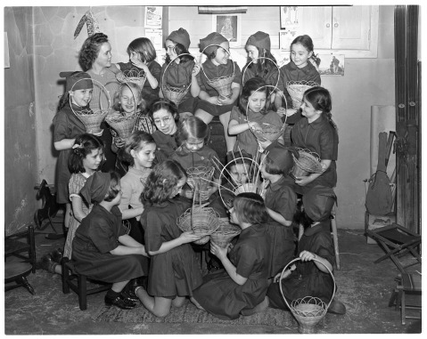 1939 Brownie Scouts making baskets